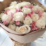 bunch of roses white and pink from a florist shop